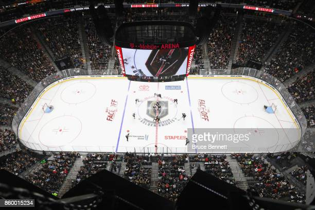 The opening faceoff is taken between the Vegas Golden Knights and the Arizona Coyotes during the Golden Knights' inaugural regularseason home opener...