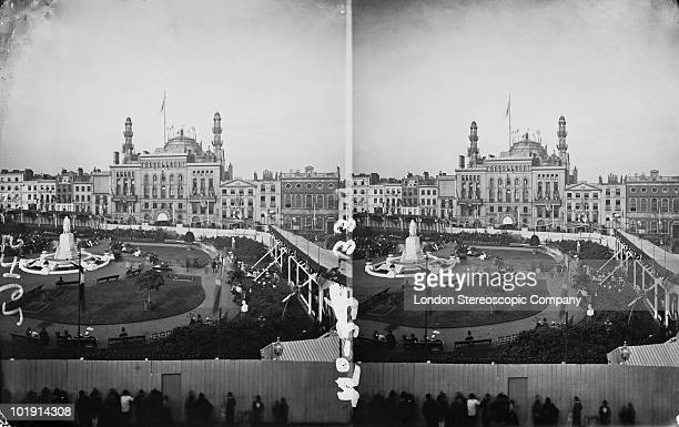 The opening of Leicester Square Gardens in London 3rd July 1874 In the background is the Alhambra theatre A line of people are trying to peer through...