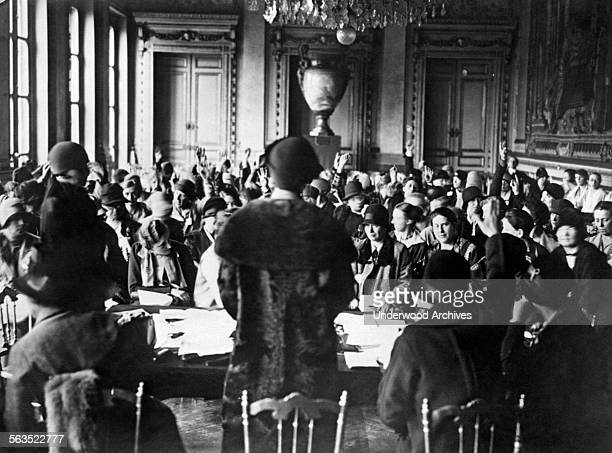 The opening of the International Congress of Women Doctors, Paris, France, circa 1929. A vote by raised hands is taking place on a proposed amendment...