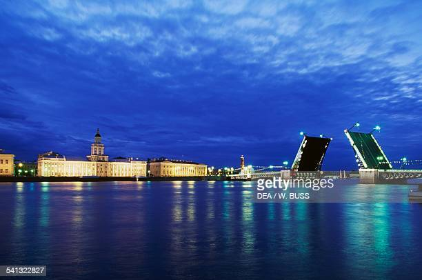The opening of the Palace Bridge on the Neva river during the White Nights Festival of the end of June St Petersburg Russia