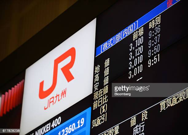 The opening price of Kyushu Railway Co shares is displayed on an electronic board at the trading floor of the Tokyo Stock Exchange operated by Japan...