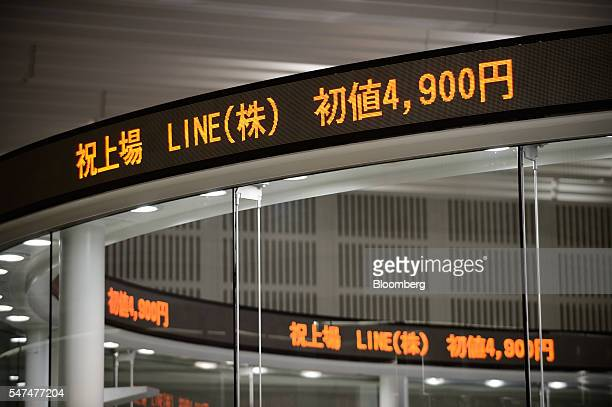 The opening price of Line Corp shares is displayed on an electronic ticker at the trading floor of the Tokyo Stock Exchange operated by Japan...
