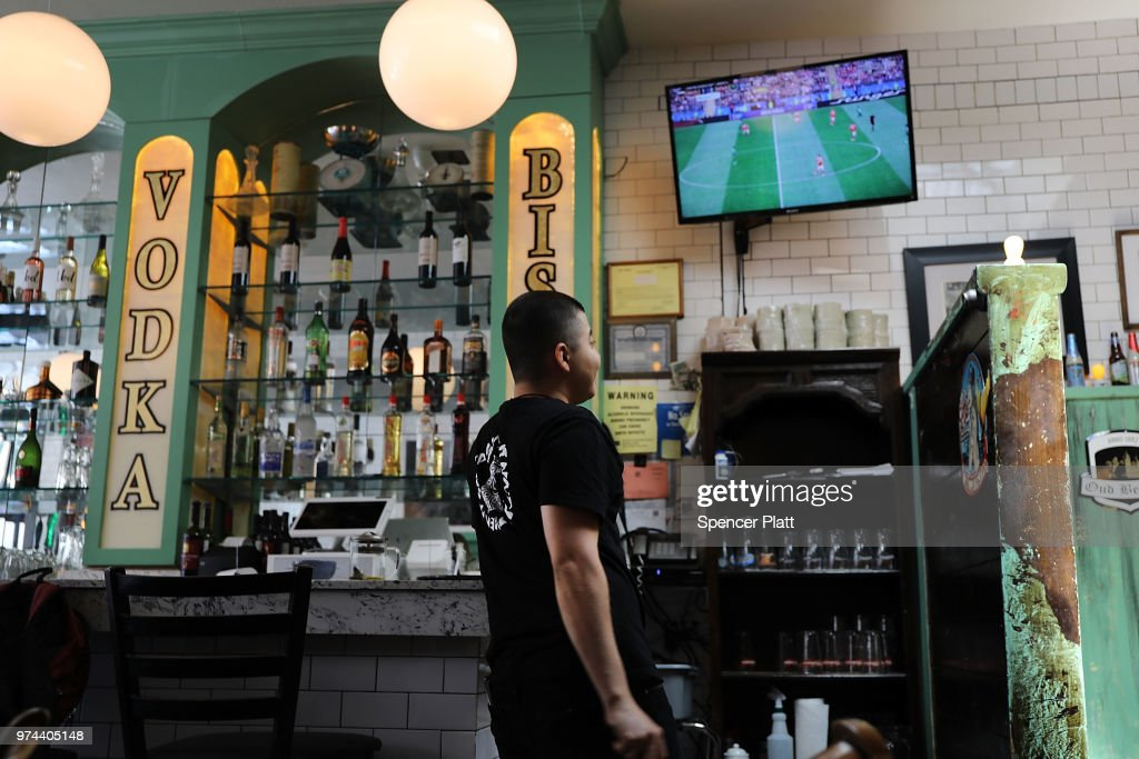 The opening soccer match of the 2018 FIFA World Cup plays at Cafe Max in Russian enclave Brighton Beach June 14, 2018 in the Brooklyn borough of New York City. The 2018 World Cup, one the world's premier sporting events, is being hosted by Russia this year as the country looks to improve its relations with the West.