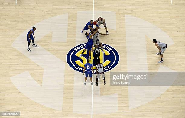 The opening tip of the Kentucky Wildcats 8277 OT win over the Texas AM Aggies in the Championship Game of the SEC Basketball Tournament at...