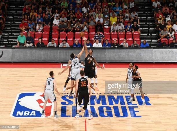 The opening tip off begins between Brandon Ashley of the Dallas Mavericks and Marquese Chriss of the Phoenix Suns during the 2017 Summer League on...