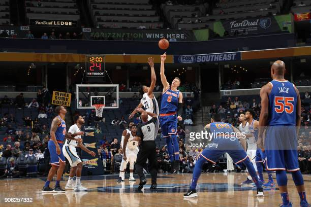 The opening tip off begins between Deyonta Davis of the Memphis Grizzlies and Kristaps Porzingis of the New York Knicks on January 17 2018 at...