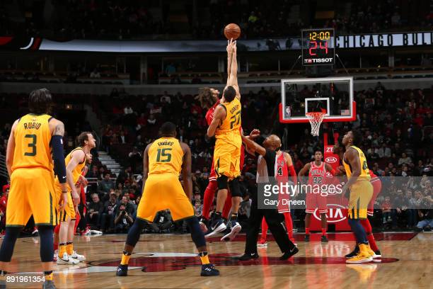 The opening tip off begins between Rudy Gobert of the Utah Jazz and Robin Lopez of the Chicago Bulls on December 13 2017 at the United Center in...