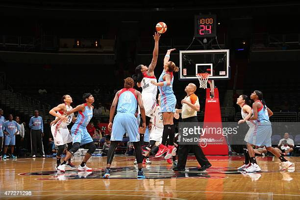 The opening tip off between Kia Vaughn of the Washington Mystics and Erika de Souza of the Atlanta Dream in a WNBA game at the Verizon Center on June...