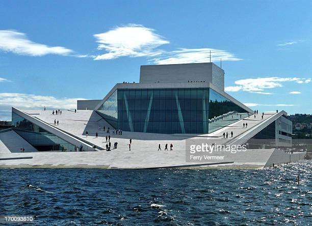 The Opera House in Oslo, Norway , seen here from the opposite quay, is the home of The Norwegian National Opera and Ballet. It is situated at the...