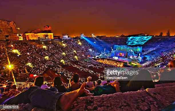 The opera Madame Butterfly of Giacomo Puccini is played in the Arena of Verona and visitors relax on the stone steps on July 14 2010 in Verona Italy...