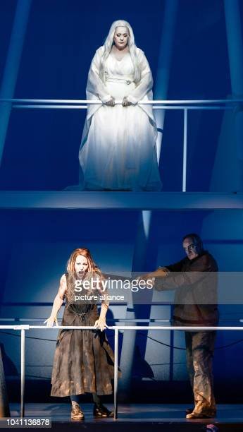 The opera singers Emily Magee as the Empress , Lise Lindstrom as Barak's wife and Andrzej Dobber as Barak during the photo rehearsal of the opera...
