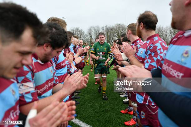 The OPM players form a tunnel for the Plymstock Albion Oaks players following the Lockie Cup Semi Final match between Old Plymouthian and...