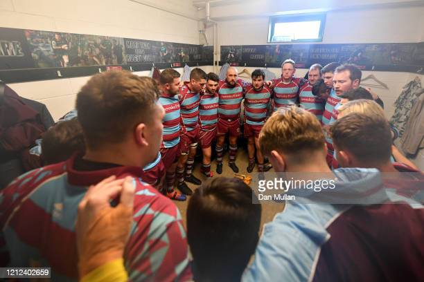 The OPM players huddle in the changing room at half time during the Lockie Cup Semi Final match between Old Plymouthian and Mannameadians and...