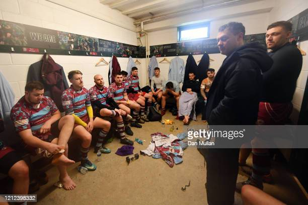 The OPM players sit dejected in the changing room following their defeat during the Lockie Cup Semi Final match between Old Plymouthian and...