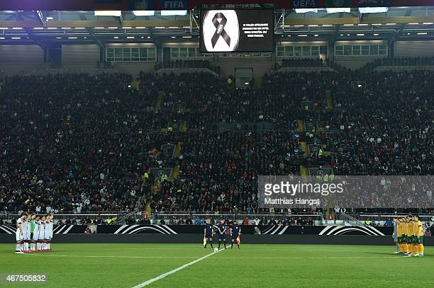 The opposing teams observe a minutes silence in remembrance of the victims of Germanwings flight 4U9525 prior to kickoff during the International...