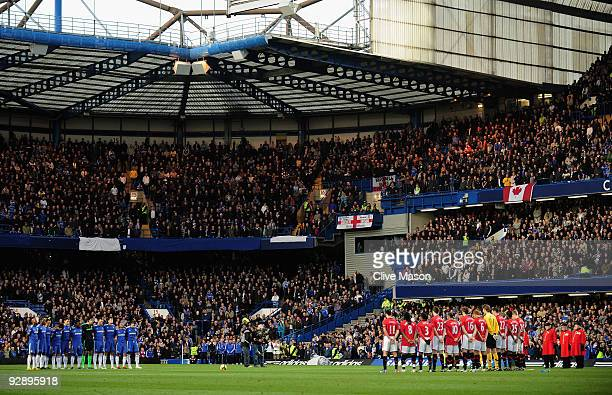 The opposing teams observe a minutes silence prior to kickoff during the Barclays Premier League match between Chelsea and Manchester United at...
