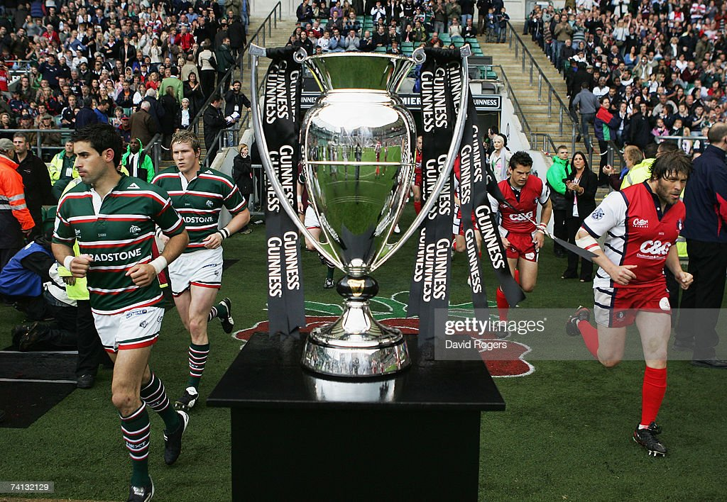 The opposing teams run out past the trophy prior to kickoff during the Guinness Premiership final between Gloucester and Leicester Tigers at Twickenham on May 12, 2007 in London, England.