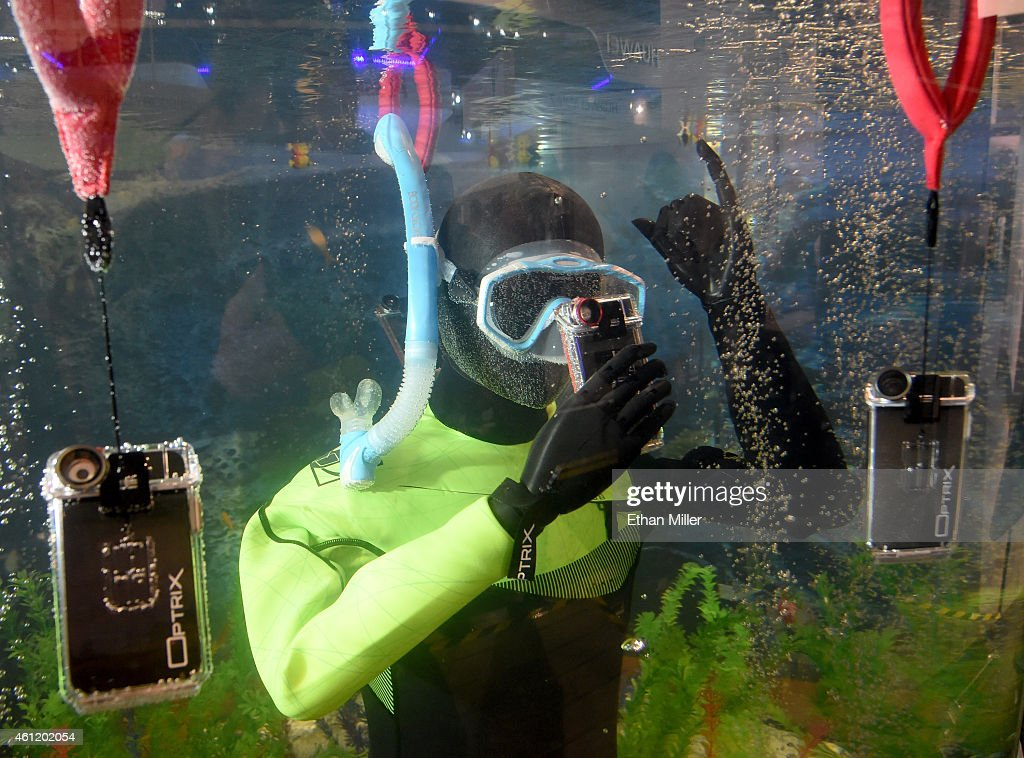 The Optrix by Body Glove is displayed underwater at the 2015 International CES at the Las Vegas Convention Center on January 8, 2015 in Las Vegas, Nevada. The Optrix is a waterproof iPhone housing with interchangeable lenses for mobile action photography and allows real-time editing of photos and video on the iPhone. The version being released in April 2015 for the iPhone 6 will be waterproof up to 30 feet deep. CES, the world's largest annual consumer technology trade show, runs through January 9 and is expected to feature 3,600 exhibitors showing off their latest products and services to about 150,000 attendees.