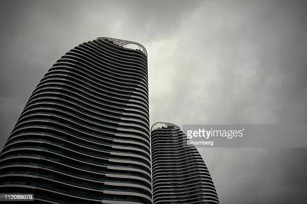 The Oracle a newly constructed twotower luxury apartment development stands in Broadbeach a suburb of the Gold Coast in Australia on Monday March 28...