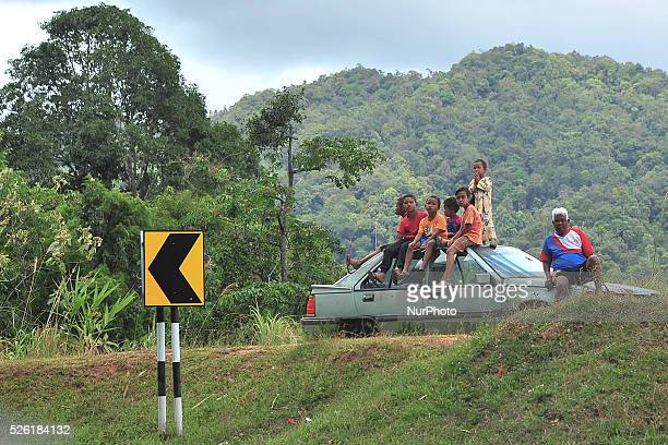 The Orang Asli the indigenous minority peoples of Peninsular Malaysia watch the fourth stage of the Tour de Langkawi 2016 the 1294 km from Ipoh to...