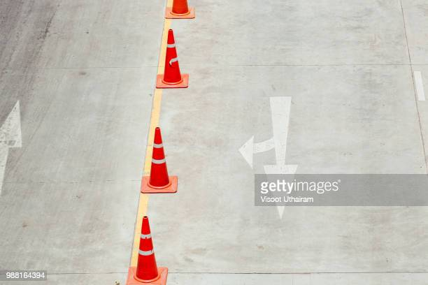 the orange cone is an object of the forbidden parking - cone shape stock pictures, royalty-free photos & images