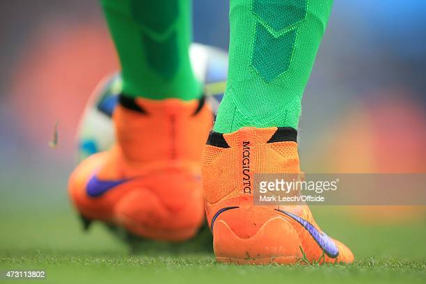 The orange Nike Magista boots worn by Man City goalkeeper Joe Hart seen during the Barclays Premier League match between Manchester City and Queens...