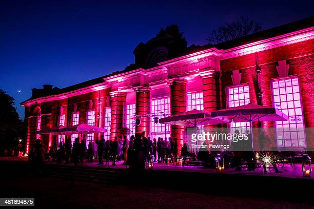 The Orangery at Kensington Palace is turned pink with lights at the Cosmopolitan A Celebration of Female Talent event during day two of Advertising...