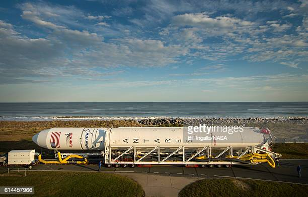 The Orbital ATK Antares rocket is rolled from the Horizontal Integration Facility to launch Pad0A Thursday Oct 13 2016 at NASA's Wallops Flight...