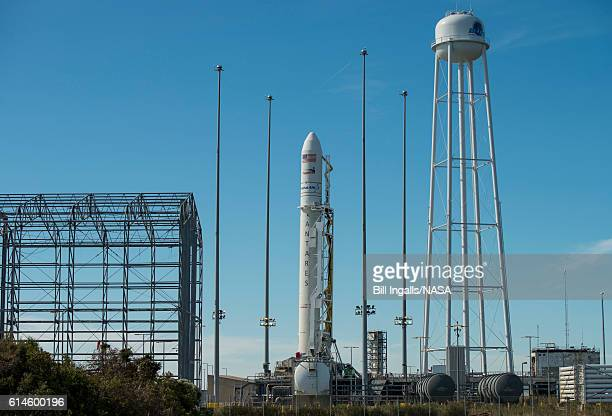 The Orbital ATK Antares rocket with the Cygnus spacecraft onboard is raised into the vertical position on launch Pad0A Friday Oct 14 2016 at NASA's...