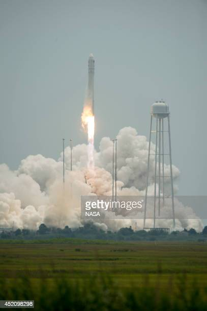 The Orbital Sciences Corporation Antares rocket with the Cygnus spacecraft onboard is pictured launching from Pad0A on July 13 at NASA's Wallops...