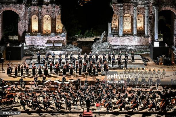 The orchestra and choir from the Teatro Massimo Bellini in Catania perform Carl Orff's Medieval Carmina Burana at the Teatro Antico in Taormina on...