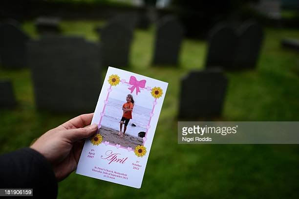The order of service for murdered schoolgirl April Jones is displayed for the photographer as her funeral service is held at St Peter's Church on...