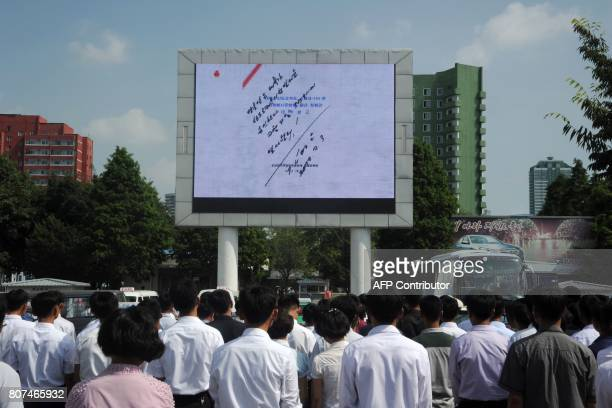 The order to carry out the test-fire of the intercontinental ballistic missile Hwasong-14 as signed by North Korean leader Kim Jong-Un is seen on a...