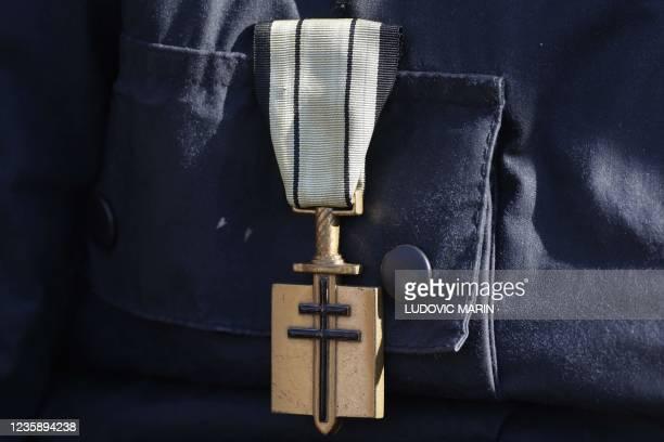 "The ""Ordre de la liberation"" emblem is seen on a veteran's uniform during a national memorial service for Hubert Germain - the last surviving..."