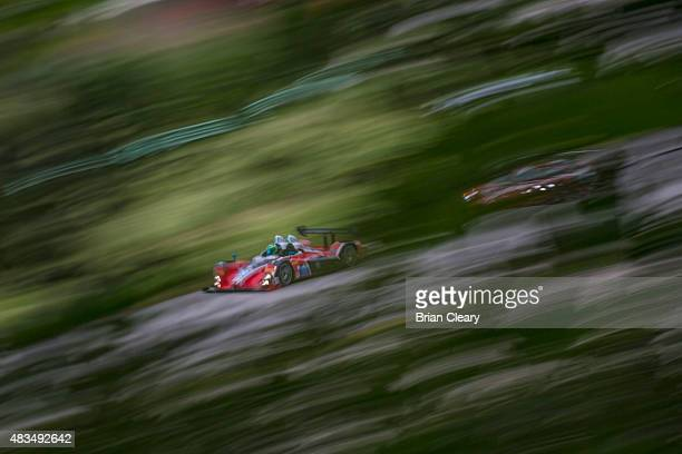 The ORECA FLM09 of James Franch and Conor Daly races past some trees during the morning warmup before the IMSA Tudor series race at Road America on...