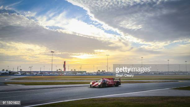 The ORECA LMP2 of Chris Miller Scott Simpson of South Africa Misha Goikhberg of Russia and Gustavo Menezes races on the track during the Rolex 24 at...