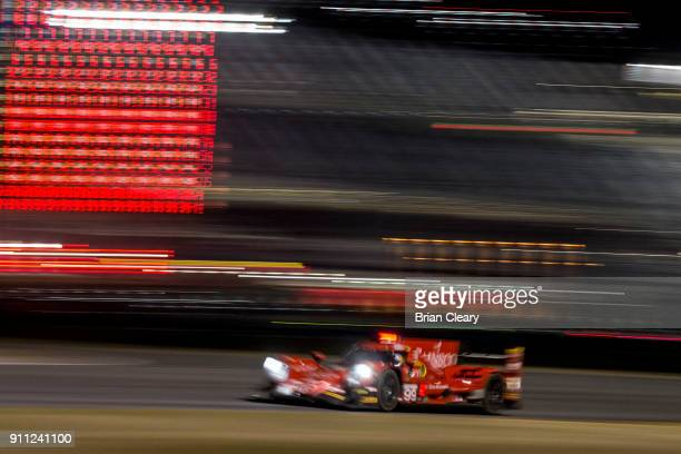 The ORECA LMP2 of Chris Miller Stephen Simpson of South Africa Misha Goihkberg of Russia and Gustavo Menezes races on the track at night during the...