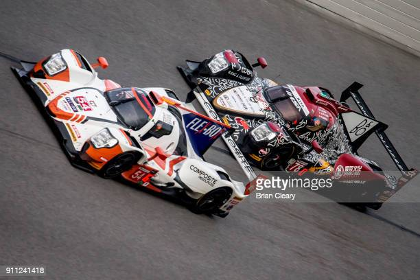 The ORECA LMP2 of Jonathan Bennett Colin Braun Romain Dumas of France and Loic Duval of France races on the track during the Rolex 24 at Daytona at...