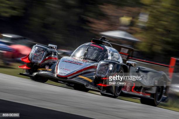 The ORECA LMP2 of Simon Pagenaud, of France, Helio Castroneves, of Brazil, and Juan Pablo Montoya, of Colombia, races on the track during practice...