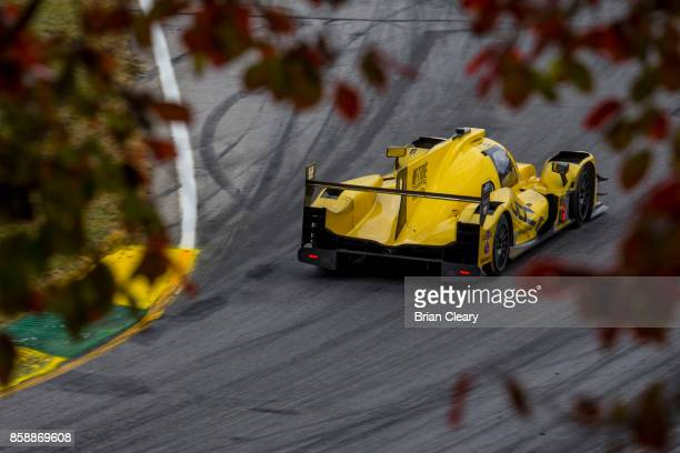 The ORECA LMP2 of Stephen Simpson, of South Africa, Misha Goikhberg, of Russia, and Chris Miller races on the track during the Motul Petit Le Mans at...
