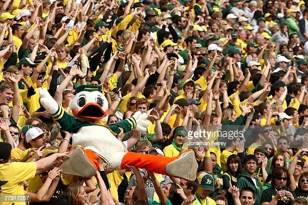 The Oregon Duck mascot is carried by the crowd against the Washington State Cougars at Autzen Stadium October 13 2007 in Eugene Oregon