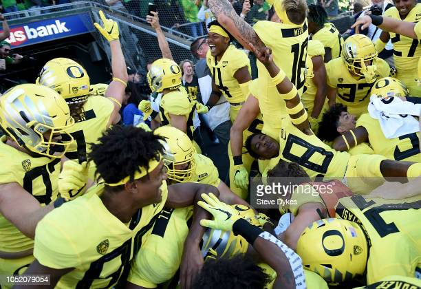 The Oregon Ducks celebrate after running back CJ Verdell of the Oregon Ducks scored the winning touchdown in overtime of the game against the...