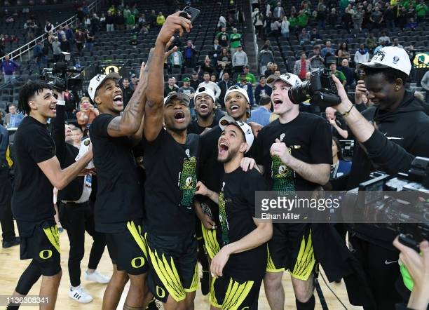 The Oregon Ducks celebrate on the court following their 68-48 victory over the Washington Huskies to win the championship game of the Pac-12...