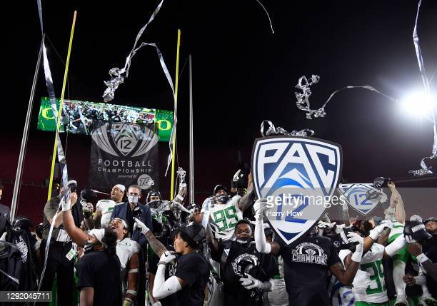 The Oregon Ducks celebrates a 31-24 win over the USC Trojans during the PAC 12 2020 Football Championship at United Airlines Field at the Coliseum on...