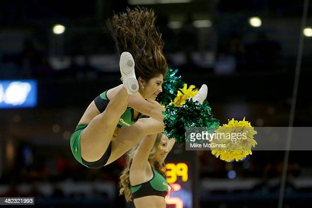 The Oregon Ducks cheerleaders perform in the first half against the Wisconsin Badgers during the third round of the 2014 NCAA Men's Basketball...