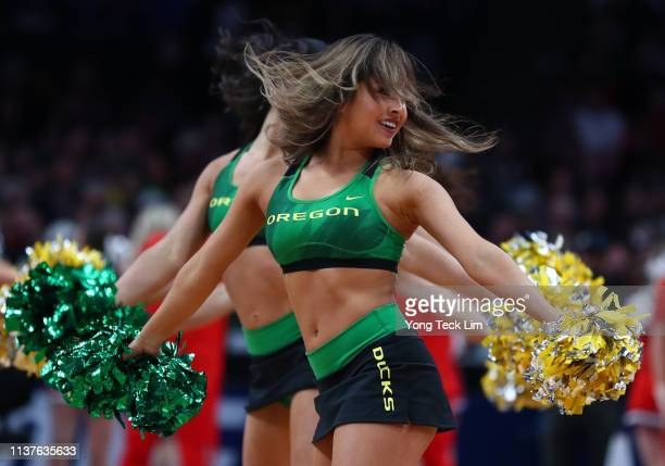 The Oregon Ducks cheerleaders perform in the first half during the first round of the 2019 NCAA Men's Basketball Tournament at SAP Center on March 22...