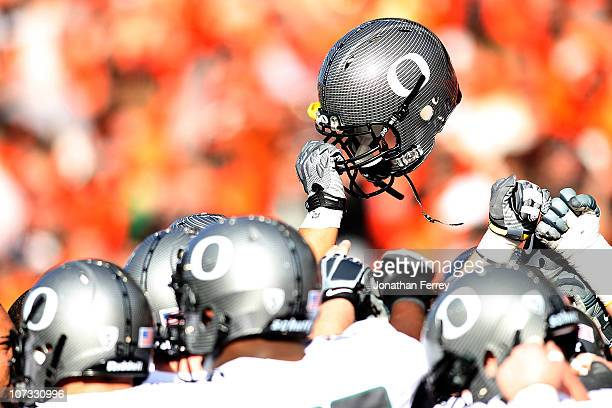 The Oregon Ducks hold their helmets high before the game against the Oregon State Beavers during the 114th Civil War on December 4 2010 at the Reser...