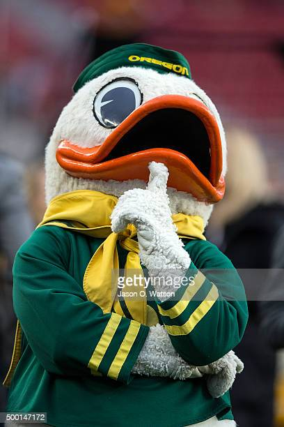 The Oregon Ducks mascot stands on the field during warmups before the Pac12 Championship game between the Stanford Cardinal and the USC Trojans at...
