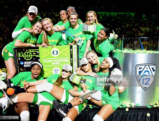 The Oregon Ducks pose onstage after defeating the Stanford Cardinal 89-56 to win the championship game of the Pac-12 Conference women's basketball...