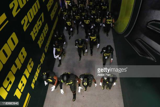 The Oregon Ducks take the field prior to taking on the Washington State Cougars during their game at Autzen Stadium on October 26 2019 in Eugene...